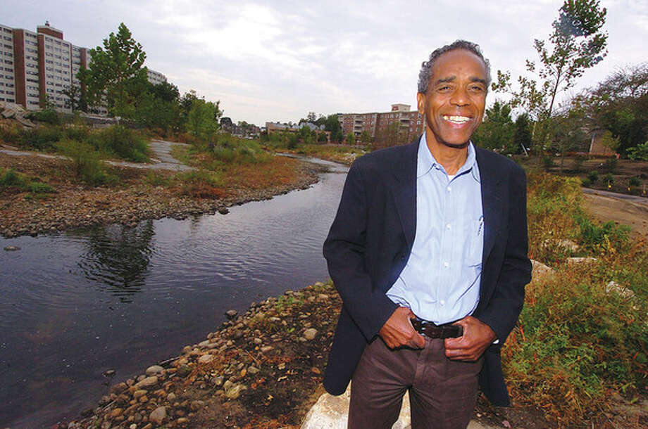 Above, Milton Puryear, executive director of the Mill River Collaborative, stands in the center of Mill River Park in Stamford. At right, a walkway in the park that is under construction.Photos by Alex von Kleydorff / 2012 The Hour Newspapers