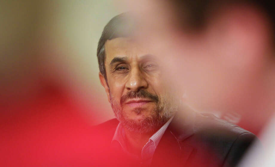 Iranian President Mahmoud Ahmadinejad listens during an exclusive interview with Associated Press editorial staff during his visit for the 67th session of the United Nations General Assembly on Tuesday, Sept. 25, 2012 in New York. (AP Photo/Bebeto Matthews) / AP