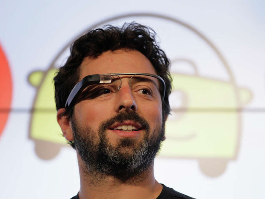 Google co-founder Sergey Brin stands on stage during a bill signing by California Gov. Edmund G. Brown Jr., for driverless cars at Google headquarters in Mountain View, Calif., Tuesday, Sept. 25, 2012. The legislation will open the way for driverless cars in the state. Google, which has been developing autonomous car technology and lobbying for the legislation has a fleet of driverless cars that has logged more than 300,000 miles (482,780 kilometers) of self-driving on California roads. Brin is wearing internet glasses. (AP Photo/Eric Risberg) / AP
