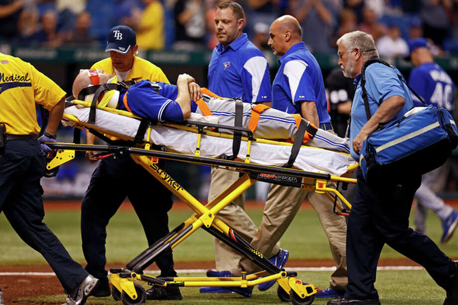 Toronto Blue Jays starting pitcher J.A. Happ is taken off the field on a stretcher after being hit with a line drive off the bat of Tampa Bay Rays' Desmond Jennings during the second inning of a baseball game Tuesday, May 7, 2013, in St. Petersburg, Fla. (AP Photo/Mike Carlson) / FR155492 AP
