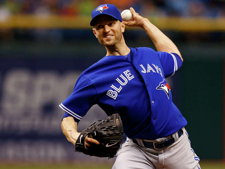 Toronto Blue Jays starting pitcher J.A. Happ throws during the first inning of a baseball game against the Tampa Bay Rays Tuesday, May 7, 2013, in St. Petersburg, Fla. (AP Photo/Mike Carlson) / FR155492 AP