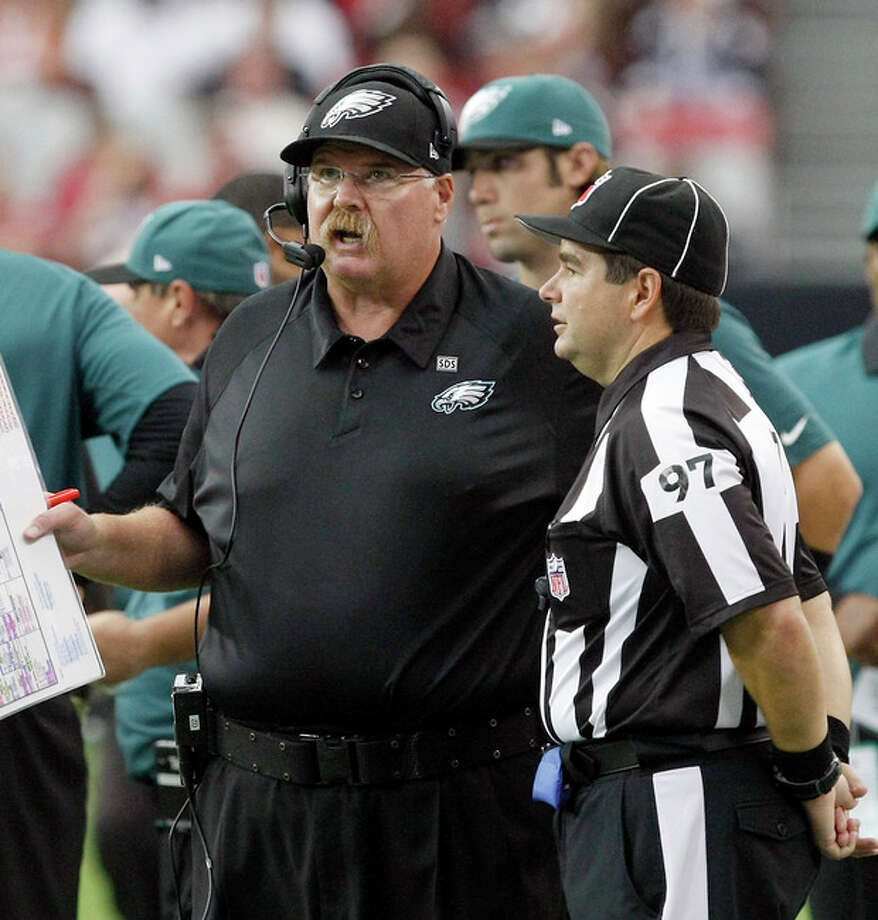 Philadelphia Eagles head coach Andy Reid, left, talks to NFL line judge George Shinkan in the fourth quarter during an NFL football game on Sunday, Sept. 23, 2012, in Glendale. (AP Photo/Rick Scuteri) / FR157181 AP
