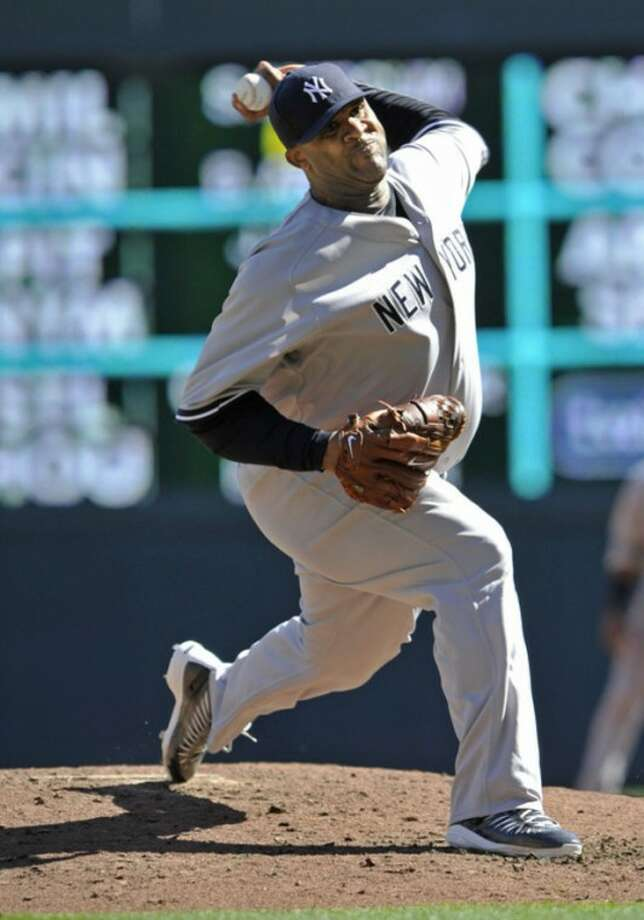New York Yankees pitcher CC Sabathia throws against the Minnesota Twins during the second inning of a baseball game, Wednesday, Sept. 26, 2012 in Minneapolis. (AP Photo/Jim Mone)