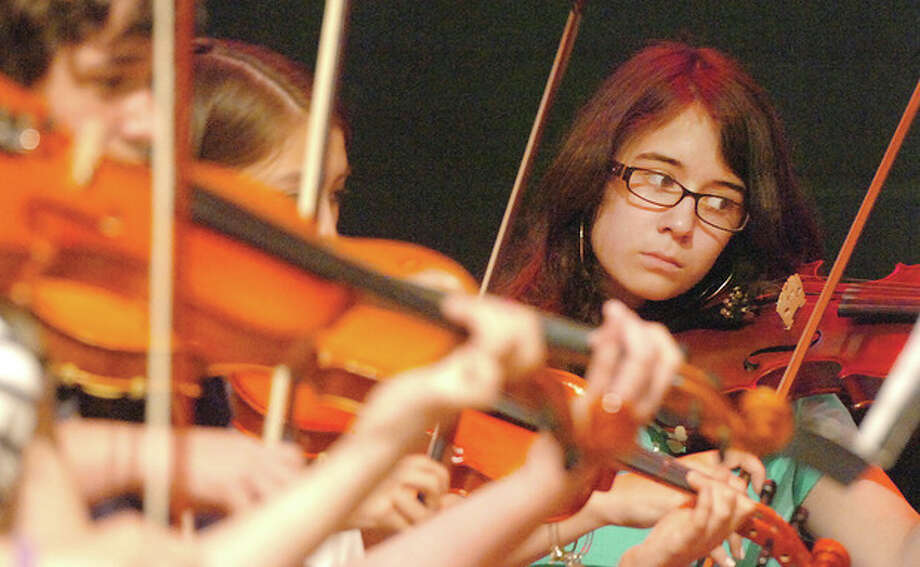 Hour photo / Alex von KleydorffSeventh-grader Katie Arpino plays the violin as the West Rocks Middle School Orchestra performs the Barber of Seville for composer Elliot Del Borgo. / 2013 The Hour Newspapers
