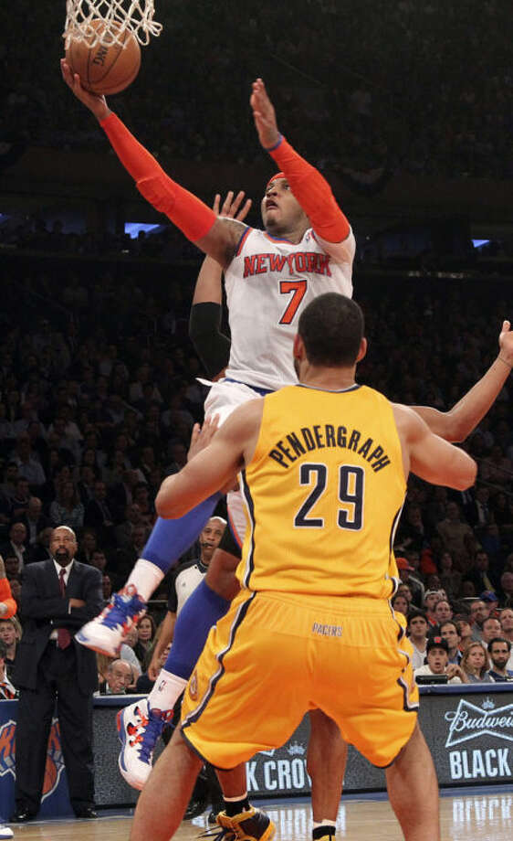 New York Knicks' Carmelo Anthony (7) shoots past Indiana Pacers' Jeff Pendergraph in the second half of Game 2 of their NBA basketball playoff series in the Eastern Conference semifinals at Madison Square Garden in New York, Tuesday, May 7, 2013. The Knicks won 105-79. (AP Photo/Mary Altaffer)
