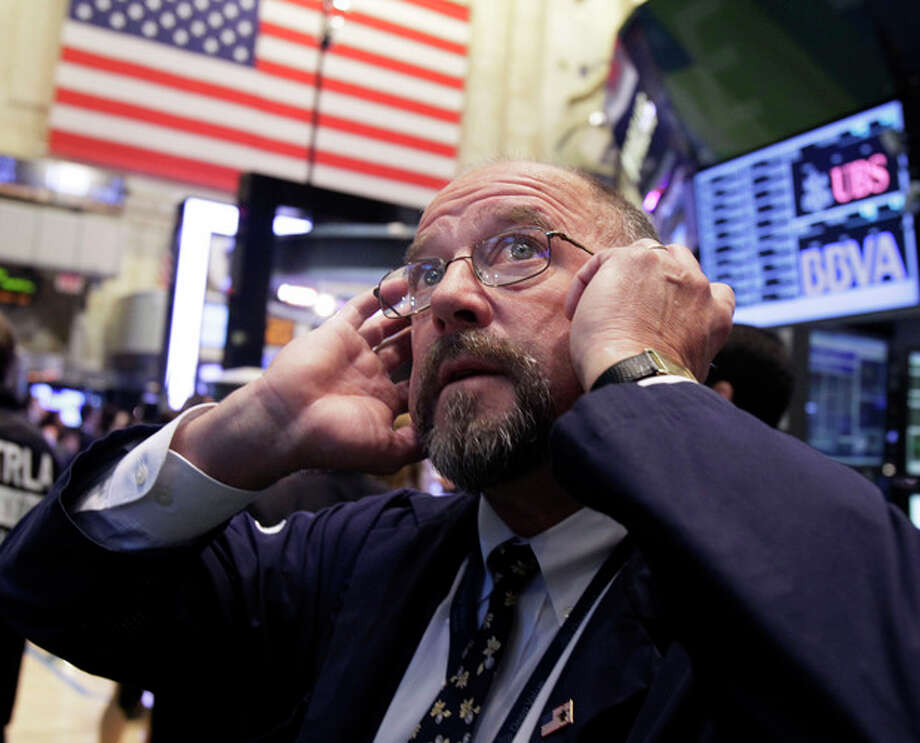 In this Sept. 20, 2012, file photo Trader Frederick Reimer works on the floor of the New York Stock Exchange. World stock markets fell Monday, Sept. 24, 2012 weighed down by a host of concerns about the global economy. (AP Photo/Richard Drew, File) / AP