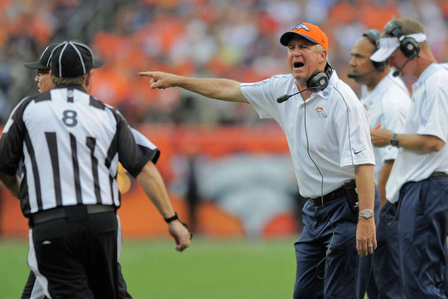Denver Broncos head coach John Fox, right, shouts to the referee in the fourth quarter of an NFL football game against the Houston Texans, Sunday, Sept. 23, 2012, in Denver. (AP Photo/Jack Dempsey) / FR42408 AP