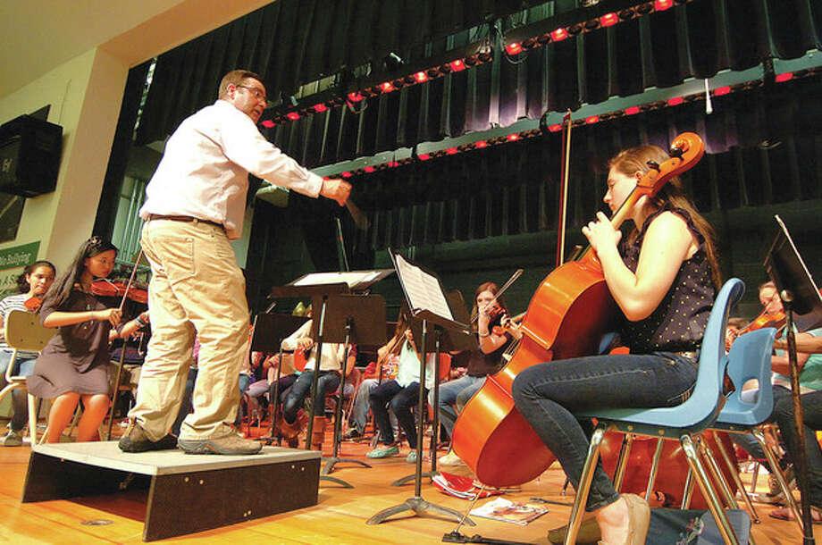Hour photo / Alex von KleydorffDavid Durell conducts the West Rocks Middle School for composer Elliot Del Borgo. / 2013 The Hour Newspapers