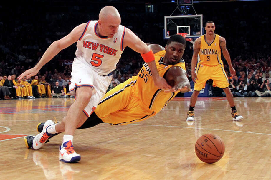 New York Knicks' Jason Kidd (5) and Indiana Pacers' Roy Hibbert dive for a loose ball in the first half of Game 2 of their NBA basketball playoff series in the Eastern Conference semifinals at Madison Square Garden in New York, Tuesday, May 7, 2013. (AP Photo/Mary Altaffer) / AP