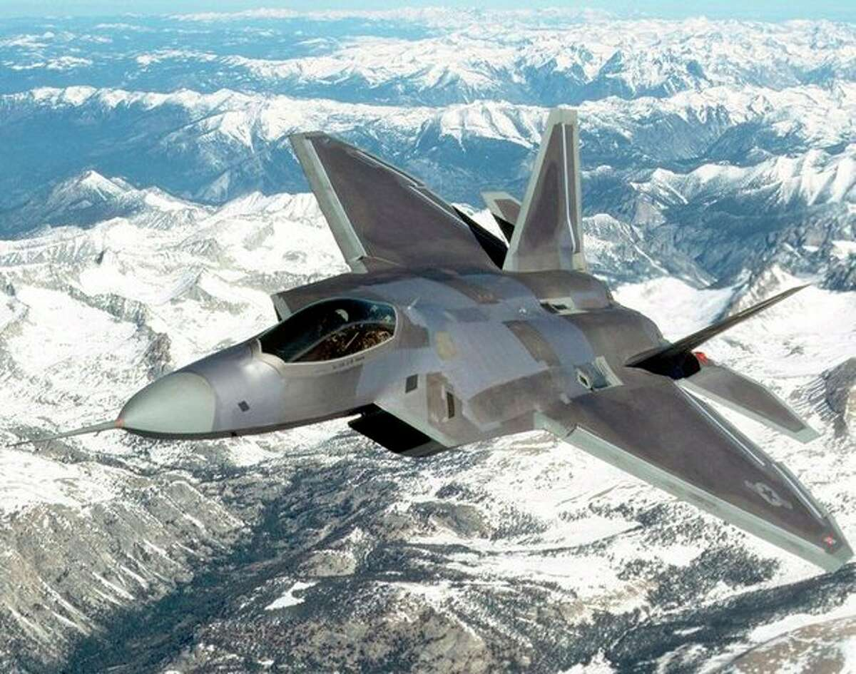 FILE - An F-22 Raptor flies near Edwards Air Force Base in Calif. , in this undated handout photo provided by Lockheed Martin. Years before F-22 pilots began getting dizzy in the cockpit, before one struggled to breathe as he tried to pull out of a fatal crash, before two more went on television to say the plane was so unsafe they refused to fly it, a small circle of U.S. Air Force experts knew something was wrong with the prized stealth fighter jet according to internal documents and emails obtained by The Associated Press. (AP Photo/Lockheed Martin, John Rossino, File)