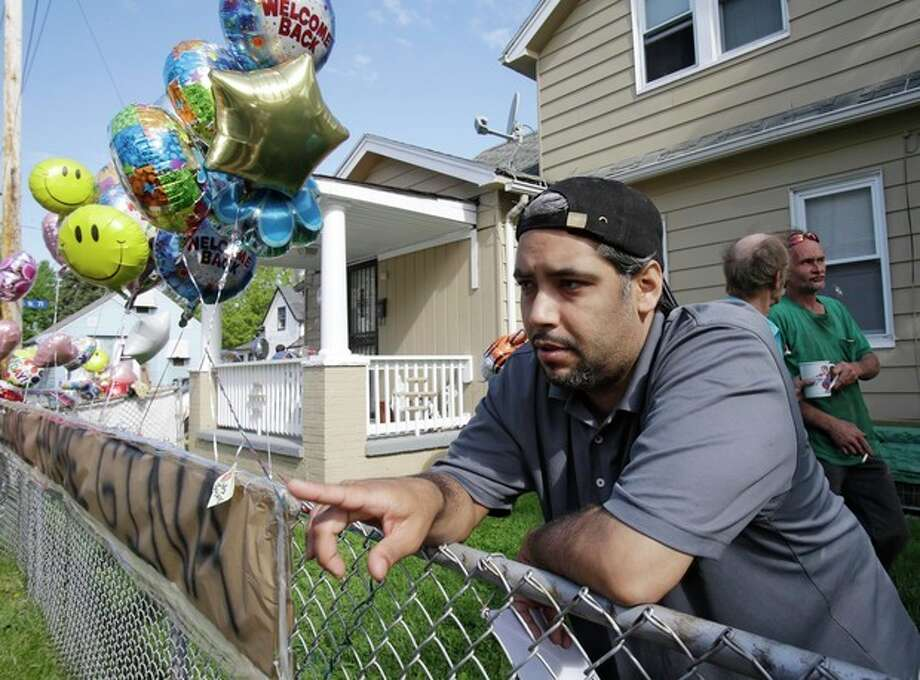 Ricardo DeJesus talks about his sister Gina at the family home Tuesday, May 7, 2013, in Cleveland. Police said Gina DeJesus and two other women who went missing separately about a decade ago were found in a house near downtown Cleveland Monday and likely had been tied up during years of captivity. Three brothers have been arrested. (AP Photo/Tony Dejak) / AP