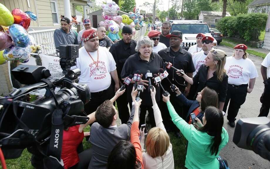 Sandra Ruiz, aunt of Gina DeJesus, talks about her visit with Gina Tuesday, May 7, 2013, in Cleveland. Gina DeJesus and two other women went missing separately about a decade ago were found in the home just south of downtown and likely had been tied up during years of captivity, said police, who arrested three brothers.(AP Photo/Tony Dejak) / AP
