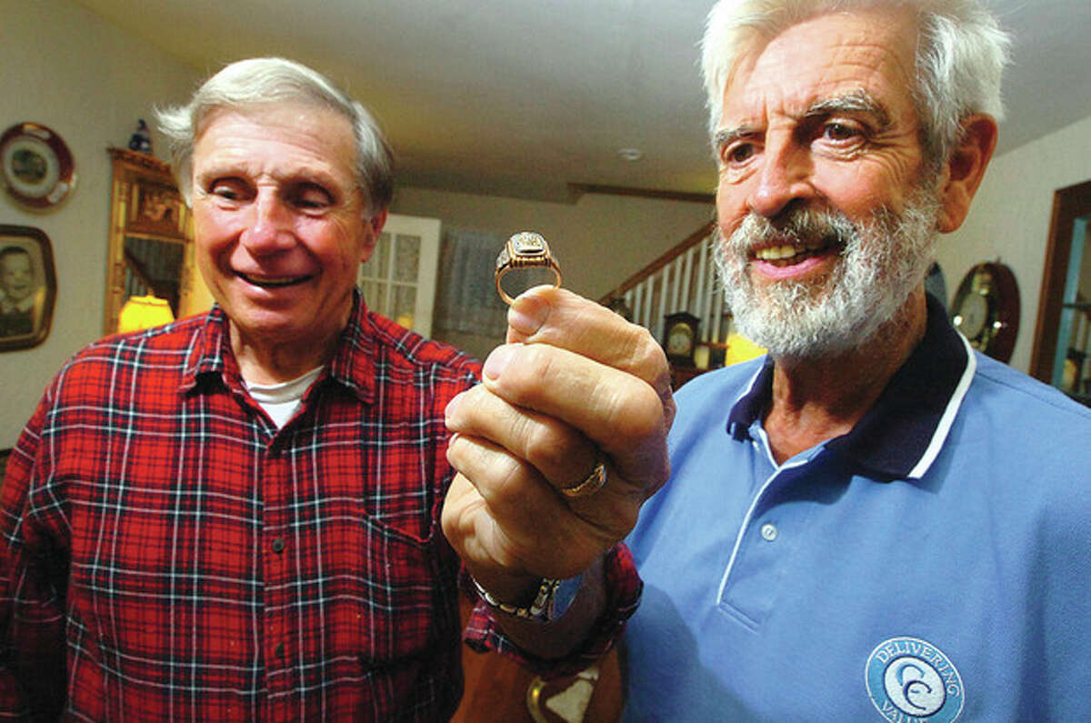 Hour photo / Alex von Kleydorff Dan Godleski, left, holds the 1953 Norwalk High School gold and onyx class ring he found and returned to Eugene Wrinn.