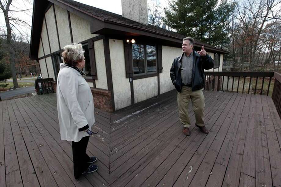 In this Tuesday, April 2, 2013, phogto, Sam and Liz Weidner, of Hudsonville, Mich., view a home for sale in Cascade Township, Mich. A survey shows U.S. home prices rose 10.5 percent in March compared with a year ago, the biggest gain since March 2006. Core Logic, a real estate data provider, said annual home prices have now increased for 13 straight months. Prices are rising in part because more buyers are bidding on a limited supply of homes for sale.. (AP Photo/Paul Sancya) / AP