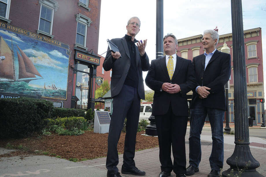 Hour photo / Matthew VinciJeff Speck of Speck and Associates and author of Walkable Cities with Timothy Sheehan, executive director of the Norwalk Redevelopment Agency and SoNo architect Bruce Beinfield on the corner of Water and Washington Streets in South Norwalk discuss the possibilities of making Norwalk more walkable.