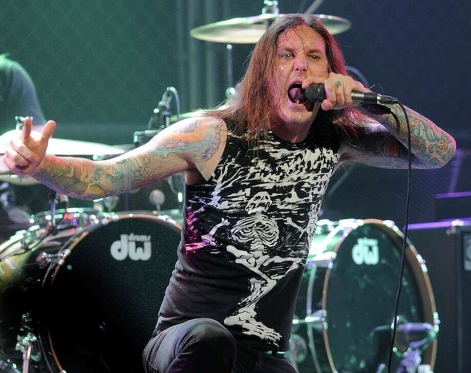 FILE - In this file photo taken Thursday, April 8, 2010, Tim Lambesis of As I Lay Dying performs at the second annual Revolver Golden Gods Awards in Los Angeles. Authorities say the singer of Grammy-nominated heavy metal band As I Lay Dying has been arrested Tuesday May 7, 2013 in Southern California after trying to hire an undercover detective to kill his estranged wife. The San Diego County Sheriff's Department says in a statement that 32-year-old Tim Lambesis was arrested Tuesday in Oceanside. (AP Photo/Chris Pizzello, File) / AP