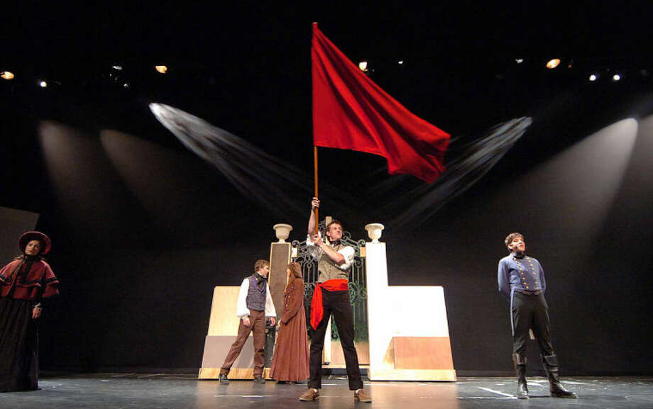 "Hour Photo/Alex von Kleydorff ""One Day More""..... Revoluntionary, Enjolras (Sacha Gilles) waves the flag backed by l-r Cosette (Gabby Pucci), Marius (Stephen Jones), Eponine (Caitlin Witty) and Javert (Nicholas Dehn)"