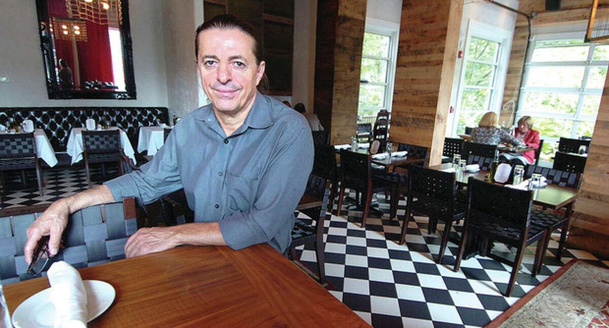 Photo by Alex von Kleydorff Tony Ramadani in his rebuilt Portofino Restaurant and Pizzeria in Wilton.