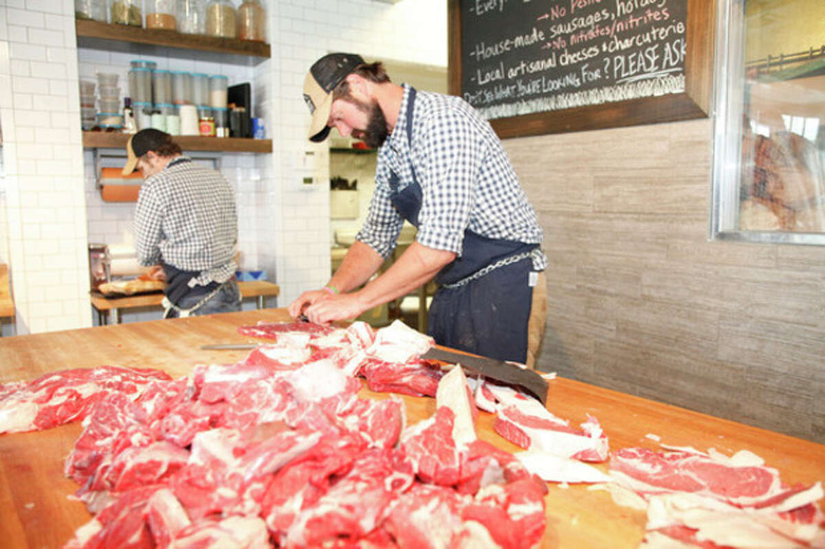 Hour Photo / Danielle Robinson Butcher Paul Nessel slices meat at Craft Butchery in Westport Thursday afternoon.