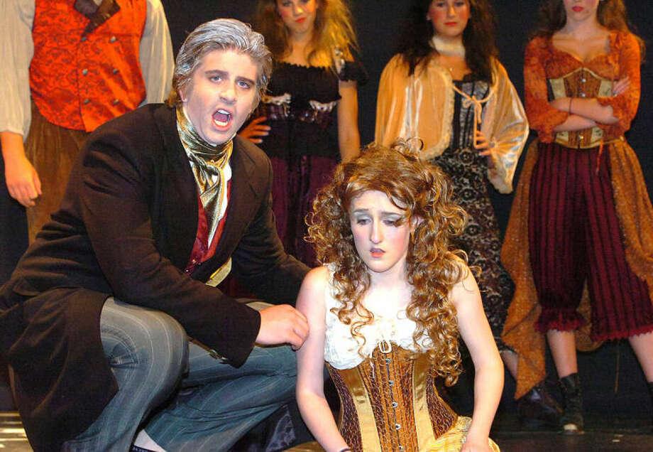 Hour Photo/Alex von Kleydorff Jean Valjean (Jack Jankowski) comes to the aid of the deperate Fantine (Erin Cobb)