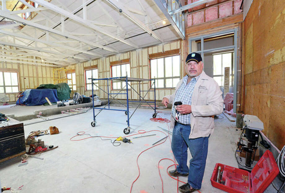 Hour photo / Erik TrautmannWinston Preparatory School Execurtive Director Scott Bezsylko shows off some of the new building as the school prepares to re-open it's doors as it finishes up construction at its Norwalk campus. / (C)2013, The Hour Newspapers, all rights reserved