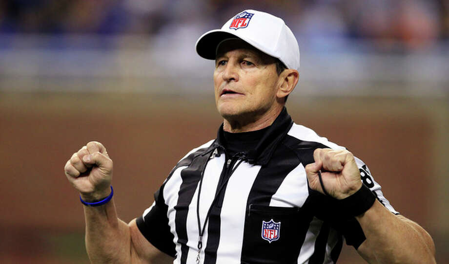 FILE - In this Dec. 24, 2011, file photo, referee Ed Hochuli (85) signals during the second quarter of an NFL football game between the Detroit Lions and the San Diego Chargers in Detroit. The NFL and referees' union reached a tentative agreement on Wednesday, Sept. 26, 2012, to end a three-month lockout that triggered a wave of frustration and anger over replacement officials and threatened to disrupt the rest of the season. (AP Photo/Carlos Osorio, File) / AP