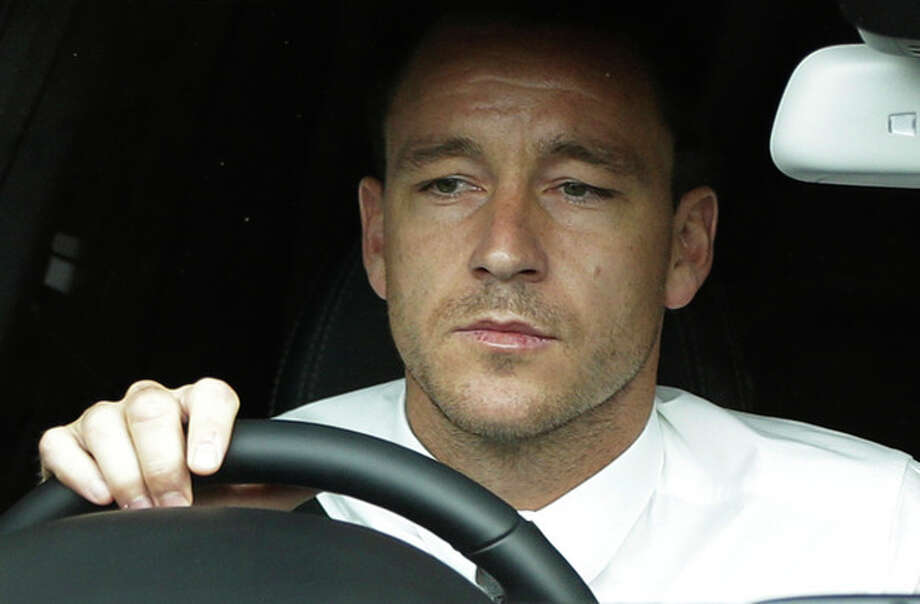 ALTERNATE CROP OF LLP101 Former England soccer captain John Terry drives out of Wembley Stadium in London, Tuesday, Sept. 25, 2012, where the Football Association hearing on a racism charge against him was held. Terry's racism hearing started Monday, a day after the 31-year-old Chelsea defender quit England duty in protest at the case being pursued by the Football Association. Terry was charged by the FA despite being cleared in court of racially abusing Queens Park Rangers defender Anton Ferdinand during a Premier League match in October. (AP Photo/Lefteris Pitarakis) / AP