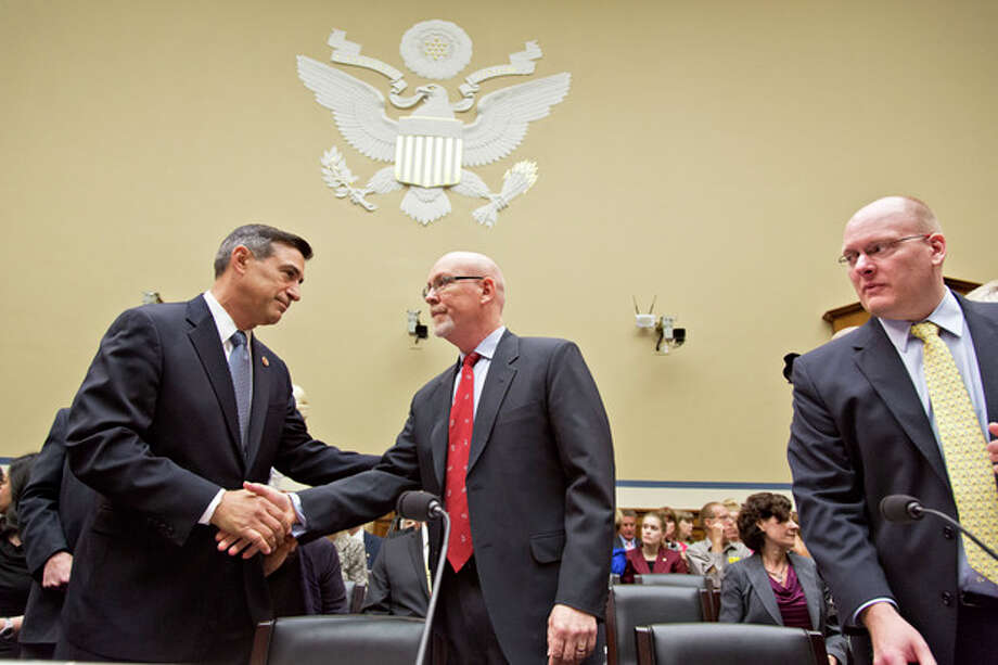House Oversight Committee Chairman Darrell Issa, R-Calif., left, welcomes Gregory Hicks, former deputy chief of mission in Libya, number two in rank to slain U.S. Ambassador Christopher Stevens, as he arrives to testify about last year's deadly assault on the U.S. diplomatic mission in Benghazi, Libya, on Capitol Hill in Washington, Wednesday, May 8, 2013. At right is Eric Nordstrom, the State Department's former regional security officer in Libya. House Republicans, led by Issa, insist the Obama administration is covering up information about the attack, rejecting administration assurances to the contrary and stoking a controversy with implications for the 2016 presidential race. (AP Photo/J. Scott Applewhite) / AP