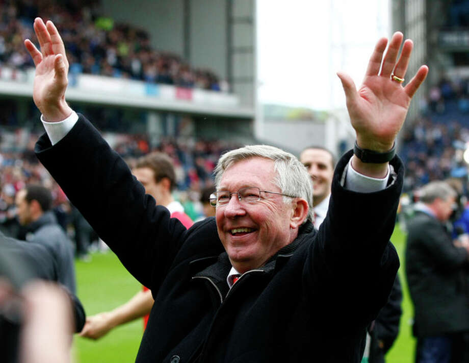 FILE - This is a Saturday May 14, 2011 file photo of Manchester United manager Alex Ferguson as he celebrates after Manchester United won the English Premier League at Ewood Park, Blackburn, England . Alex Ferguson is retiring at the end of the season it was announced Wednesday May 8, 2013, bringing a close to a trophy-filled career of more than 26 years at Manchester United that established him as the most successful coach in British football history. (AP Photo/Tim Hales, File) / AP