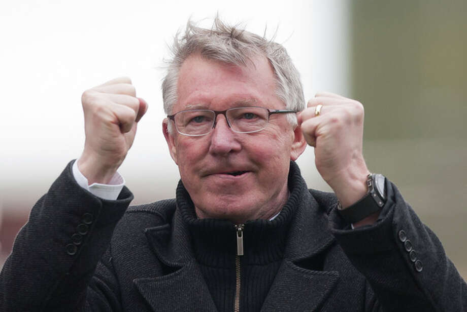 FILE - In this Sunday April 14, 2013 file photo, Manchester United's manager Sir Alex Ferguson celebrates after his team's 2-0 win over Stoke in their English Premier League soccer match at the Britannia Stadium, Stoke, England. Ferguson's future with Manchester United future is the subject of fresh uncertainty, with several British newspapers speculating that he is preparing to stand down as manager. (AP Photo/Jon Super, File) / AP