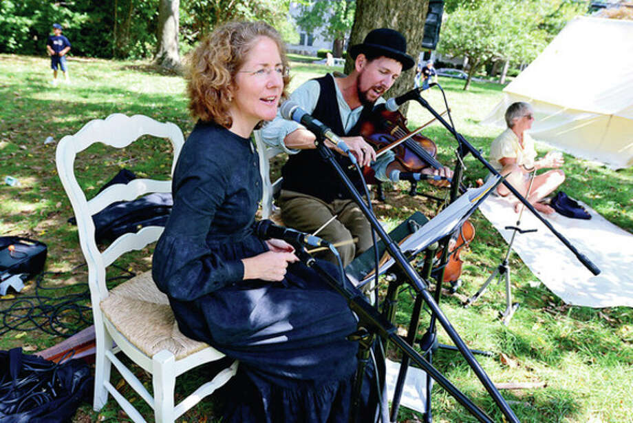 Historical musicians Deirdre and Sean Murphy play during the Rowayton Historical Society sponsored Civil War encampment at Pinkney Park Saturday where kids 6 and up to had the opportunity to be a trained like a union soldier as well as experience, music, a Civil War exhibit, and have a visit from Abe Lincoln and other historic characters.Hour photo / Erik Trautmann / (C)2012, The Hour Newspapers, all rights reserved