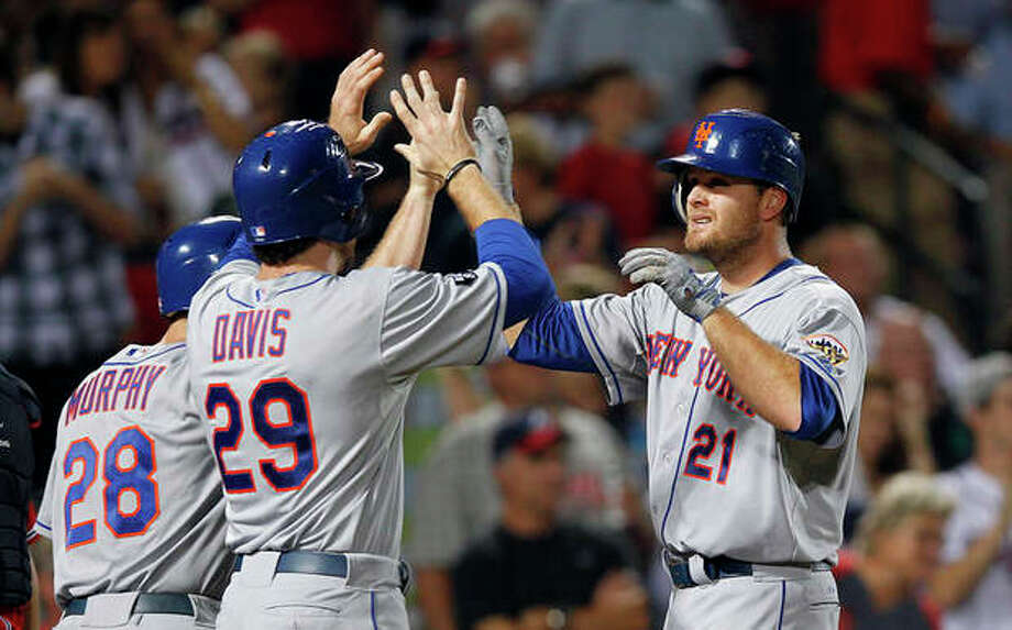 New York Mets right fielder Lucas Duda (21) celebrates with Ike Davis (29) after hitting a three-run home run in the seventh inning of a baseball game against Atlanta Braves in Atlanta, Friday, Sept. 28, 2012. (AP Photo/John Bazemore) / AP