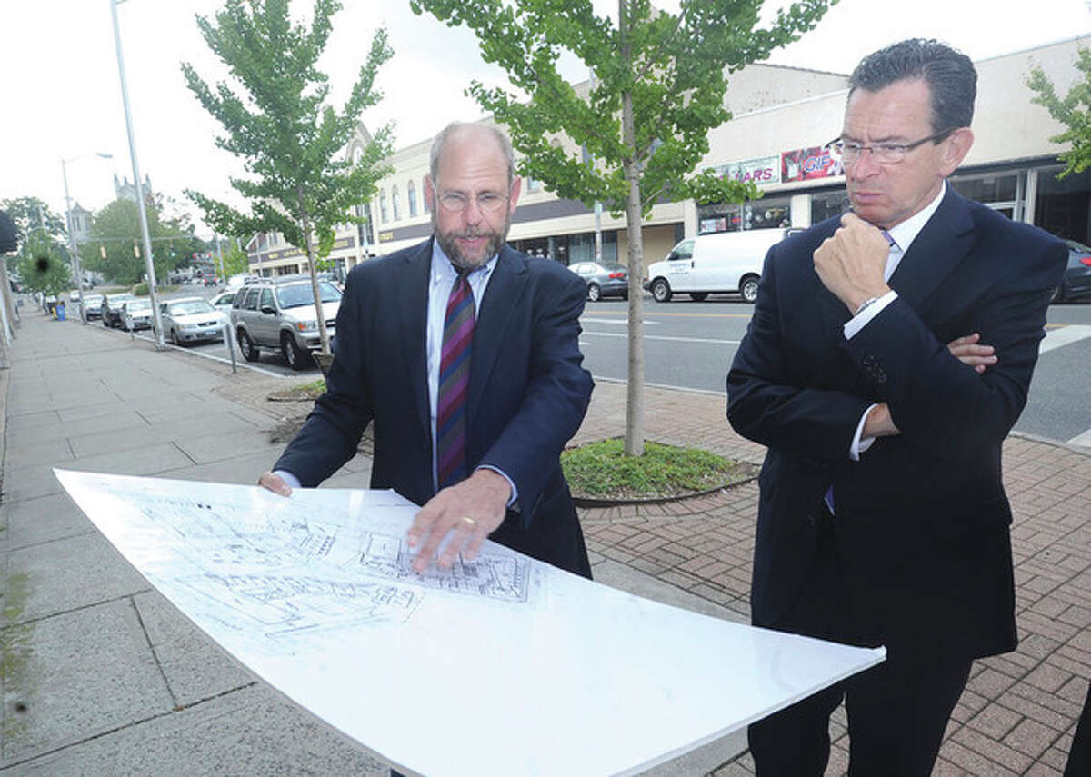 @Cutline Byline:Hour photo / Matthew Vinci Kenneth Olson, founder of POKO partners, with Gov. Dan Malloy Thursday discussing the new plans for the 65 Wall Street location in Norwalk.