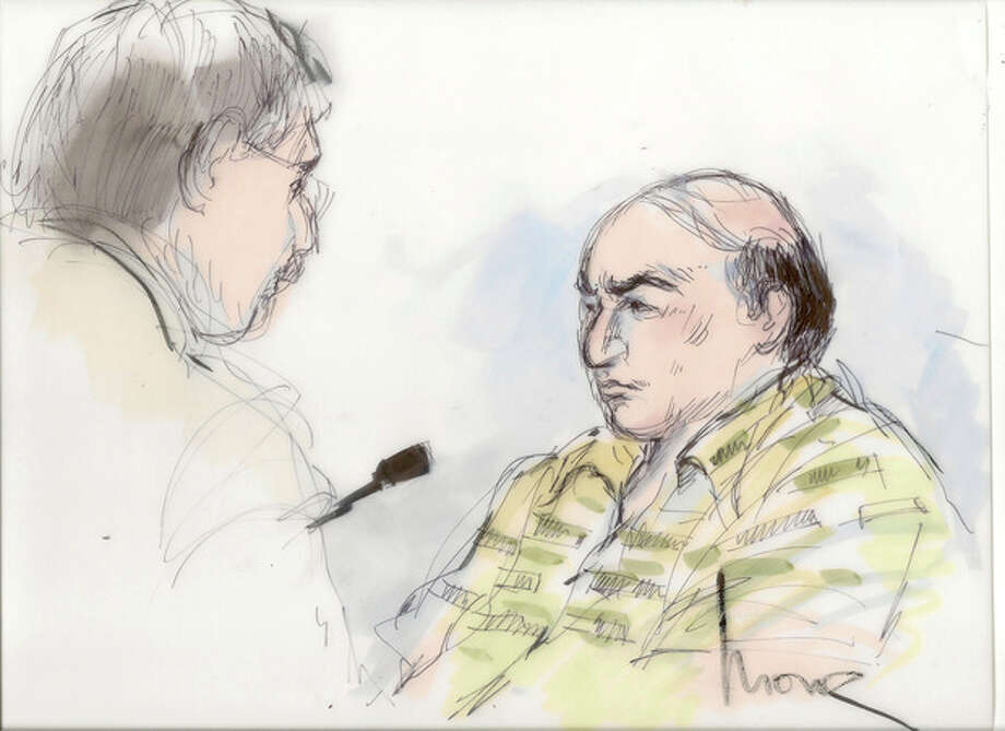 This courtroom sketch shows Nakoula Basseley Nakoula talking with his attorney Steven Seiden, left, in court Thursday Sept. 27, 2012. The U.S. Central District Chief Magistrate Judge Suzanne Segal on Thursday determined the California man behind a crudely produced anti-Islamic video that inflamed parts of the Middle East is a flight risk and ordered him detained. (AP Photo/Mona Shafer Edwards) / AP