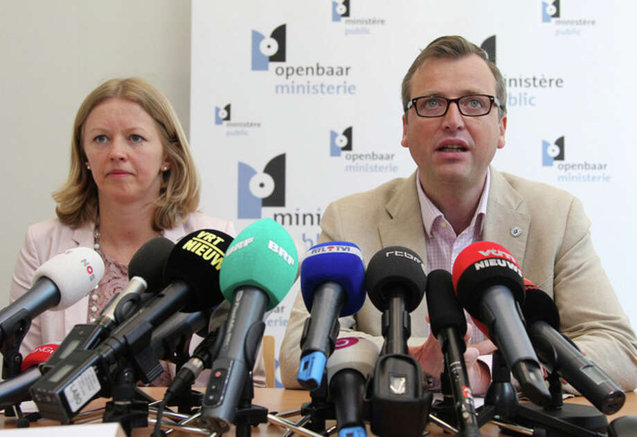 Prosecutor spokespersons Jean-Marc Meilleur, right, and Anja Bijnens address the media in Brussels, Wednesday, May 8, 2013. Police carried out a series of raids in Belgium and detained 31 people in three countries in connection with a spectacular $50 million diamond heist pulled off with apparent clockwork precision at Brussels Airport, a Belgian prosecutor said Wednesday. (AP Photo/Yves Logghe) / AP