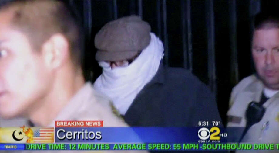 FILE - In this Sept. 15, 2012 file image from video provided by CBS2-KCAL9, Nakoula Basseley Nakoula, the man behind a crudely produced anti-Islamic video that has inflamed parts of the Middle East, is escorted by Los Angeles County sheriff's deputies from his home in Cerritos, Calif. Nakoula, 55, was arrested Thursday for violating terms of his probation, authorities said. (AP Photo/CBS2-KCAL9, File) MANDATORY CREDIT CBS-KCAL9, LOS ANGELES OUT, LOS ANGELES TV OUT / CBS-KCAL9