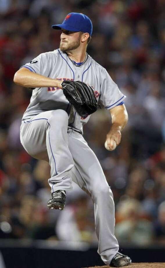New York Mets starting pitcher Jonathon Niese (49) works in the second inning of a baseball game against Atlanta Braves in Atlanta, Friday, Sept. 28, 2012. (AP Photo/John Bazemore)