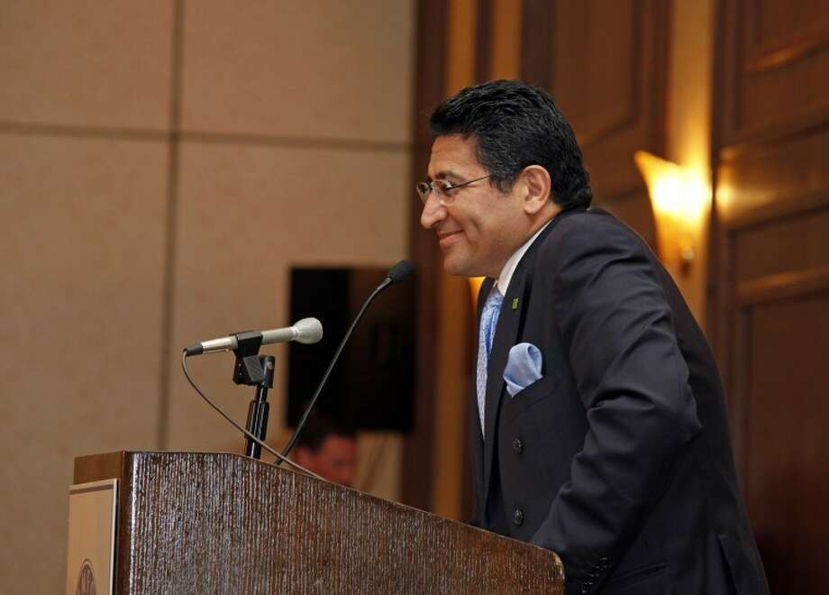 Chairman Dr. Hamid Malakpour speaks during The Stamford Chamber of Commerce's 25th annual luncheon Thursday afternoon at the Stamford Hilton. Hour Photo / Danielle Robinson