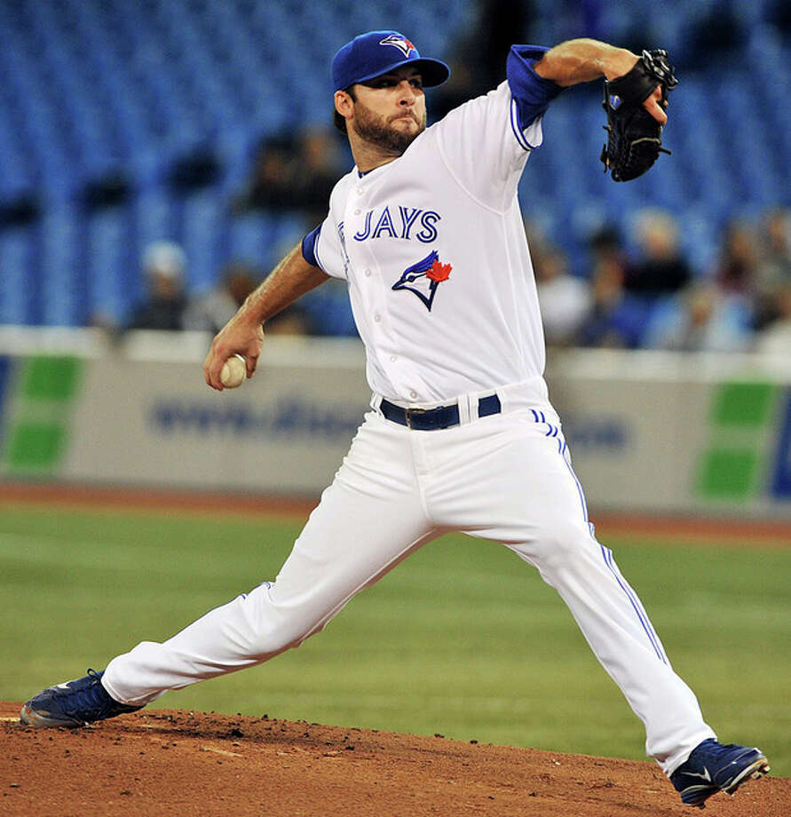 Toronto Blue Jays pitcher Brandon Morrow delivers against the New York Yankees during the first inning of a baseball game in Toronto, Thursday, Sept. 27, 2012. (AP Photo/The Canadian Press, Aaron Vincent Elkaim) / The Canadian Press