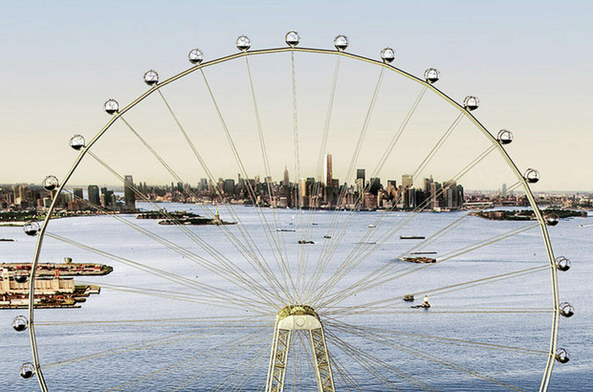 """In this image released by the New York Mayor's Office, Thursday, Sept. 27, 2012 is an artist's rendering of a proposed 625-foot Ferris wheel, billed as the world's largest, planned as part of a retail and hotel complex along the Staten Island waterfront in New York. The attraction, called the New York Wheel, will cost $230 million. Officials say the observation wheel will be higher than the Singapore Flyer, the London Eye, and a """"High Roller"""" wheel planned in Las Vegas. Beyond the wheel is the Manhattan skyline. (AP Photo/Office of the Mayor of New York)"""