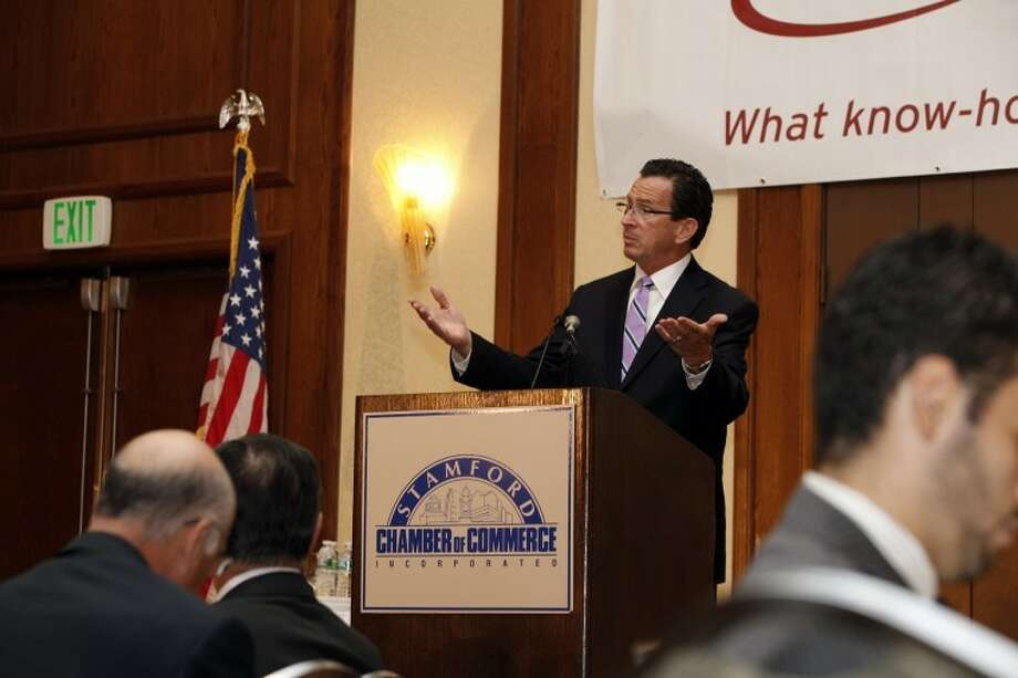 Gov. Dannel Malloy speaks at the podium of The Stamford Chamber of Commerce's 25th annual luncheon Thursday afternoon at the Stamford Hilton. Hour Photo / Danielle Robinson