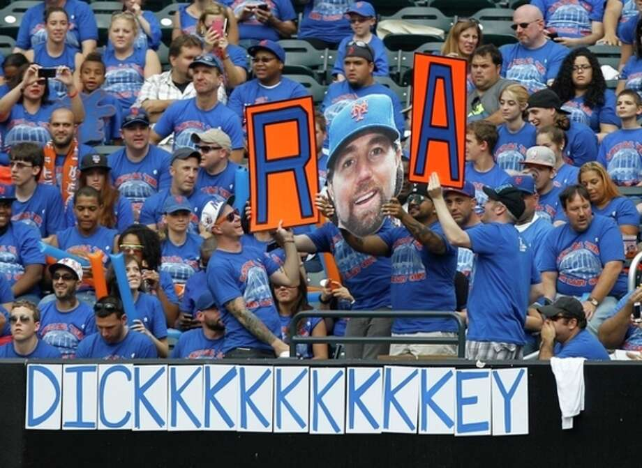 Fans pay tribute to New York Mets pitcher R.A Dickey, who is going for his 20th victory, during a baseball game against the Pittsburgh Pirates at Citi Field in New York, Thursday, Sept. 27, 2012. (AP Photo/Kathy Willens) / AP