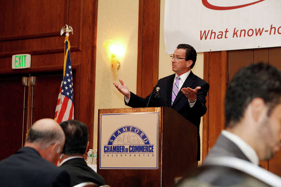 Gov. Dannel Malloy speaks at the podium of The Stamford Chamber of Commerce's 25th annual luncheon Thursday afternoon at the Stamford Hilton.Hour Photo / Danielle Robinson