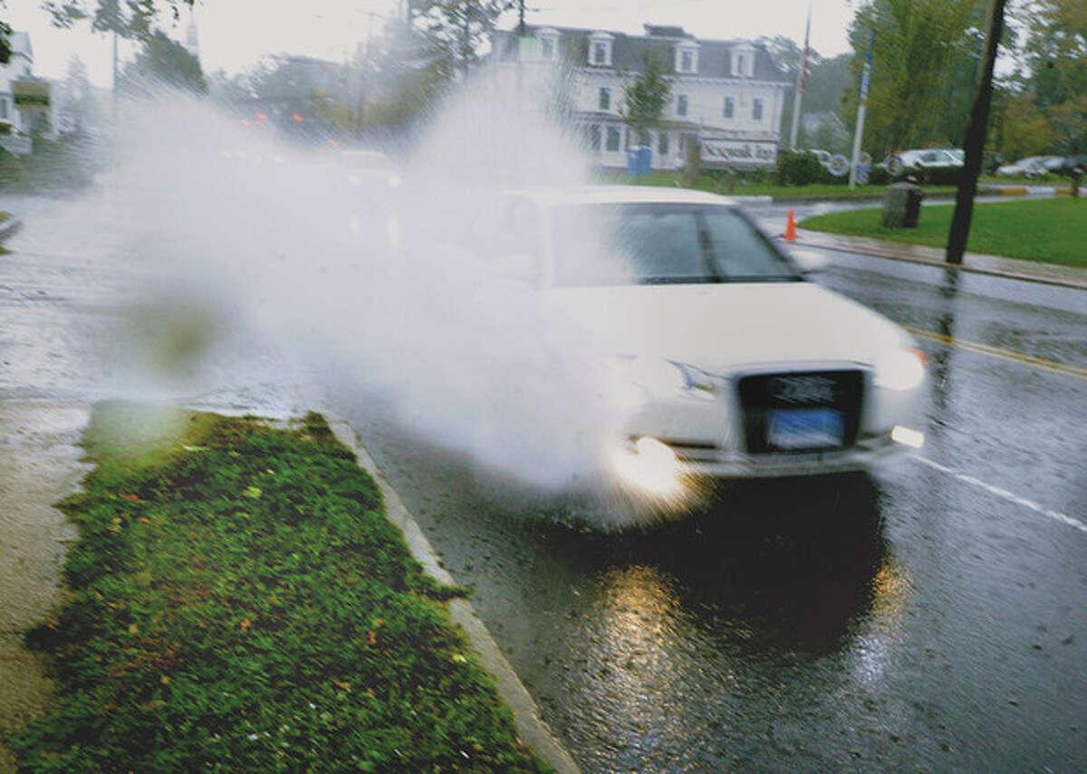 Heavy rain conditions along East Avenue Friday morning. hour photo/Matthew Vinci