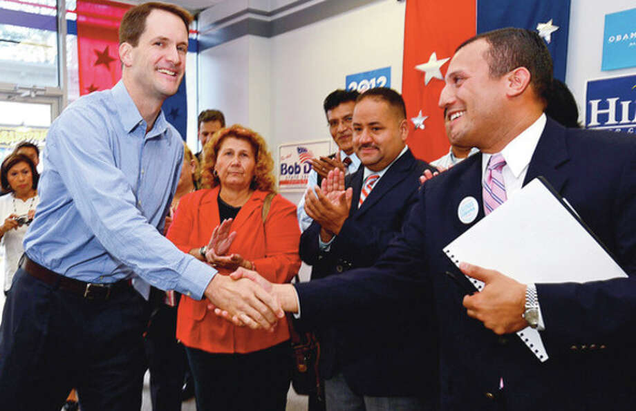 Hour photos / Erik TrautmannHispanic Democrats, from Bridgeport to Stamford, including Councilman Warren Pena, above right, rally at democratic headquarters at 20 North Main St. Saturday in support of such Democratic candidates as Congressman Jim Himes, at left. Below, Hartford mayor Pedro Segarra attends the rally. / (C)2012, The Hour Newspapers, all rights reserved