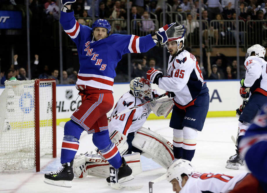 New York Rangers right wing Ryane Clowe (29) celebrates a goal scored by left wing Carl Hagelin in the second period of Game 4 of their first-round NHL hockey Stanley Cup playoff series against the Washington Capitals in New York, Wednesday, May 8, 2013. (AP Photo/Kathy Willens) / AP