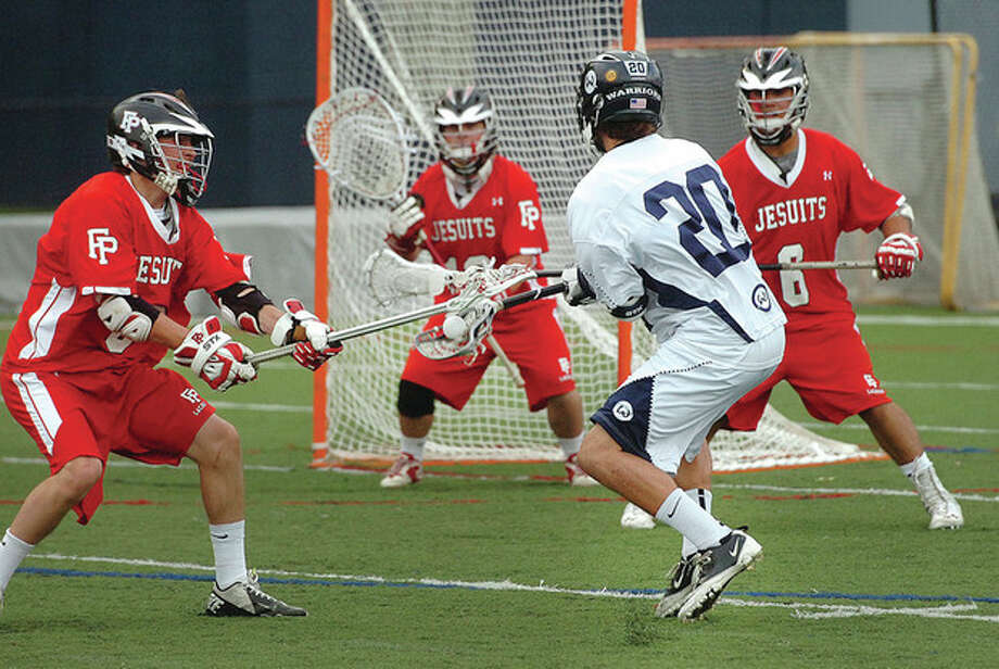 Hour photo/Alex von KleydorffWilton's Luke Reyes-Guerra-Dunn is surrounded by Fairfield Prep defenders as he tries to get off a shot during Wednesday's game in Wilton. The visiting Jesuits kept the Warriors in check and collected a 16-9 victory. / 2013 The Hour Newspapers