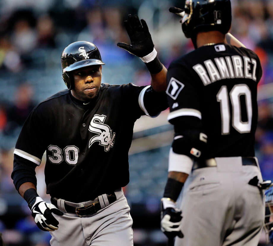 Chicago White Sox's Alejandro De Aza, left, is greeted by Alexei Ramirez after hitting a solo home run during the first inning of a baseball game against the New York Mets at Citi Field, Wednesday, May 8, 2013, in New York. (AP Photo/Seth Wenig) / AP