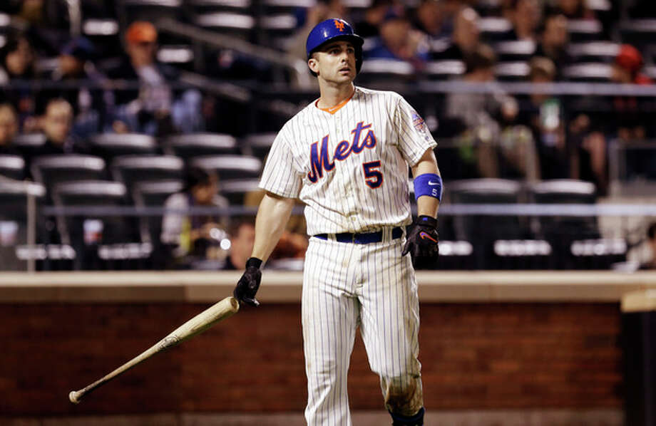 New York Mets' David Wright throws his bat after his foul ball was caught to end the sixth inning of a baseball game against the Chicago White Sox at Citi Field, Wednesday, May 8, 2013, in New York. (AP Photo/Seth Wenig) / AP