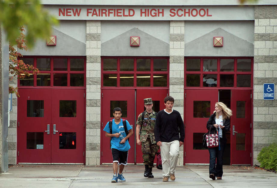 Students leave New Fairfield High School where in New Fairfield, Conn., Friday, Sept. 28, 2012. Tyler Giuliano, a student involved in Civil Air Patrol at the school was killed by his father Jeffrey Giuliano during what appeared to be an attempted burglary early Thursday morning. Giuliano fatally shot a masked teenager in self-defense, then discovered that he had killed his son, state police said. (AP Photo/Jessica Hill) / FR125654 AP